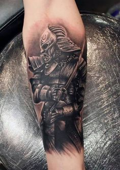 Black Ink Samurai With Sword Tattoo On Forearm
