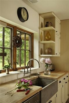 I like the Wood trim, soapstone basin, wood counter. White cupboards.