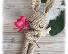 Lovely amigurumi bunny perfect soft cuddly toy for your child. Made from 100% cotton yarn. Stuffed with poly fiber fill. Measures about 22 cm (9 inches) from top to toe (incl. ears). Made in a smoke free home.  ***Please note that this item is MADE TO ORDER so please allow between 1-3 days to ship. Choose option please***   SAFETY NOTE: Please note that I have used safety eyes on this bunny - even though they have been attached securely this means that the bunny is suitable for children aged…