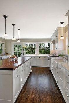 butcher block island, quartz countertops, light gray cabinets