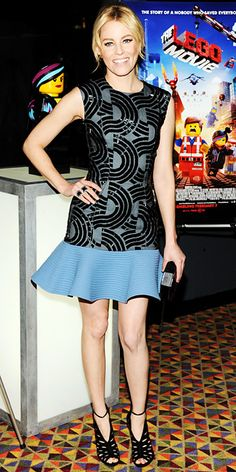Elizabeth Banks wearing a beaded David Koma mini-dress, with Jack Vartanian rings, a Rauwolf clutch, and Jimmy Choo laser-cut shoes.