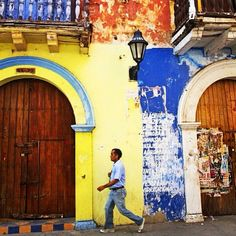 Colours of #Cartagena, #Colombia. This fairy-tale city of romance, legends and sheer beauty, #Cartagena is an addictive place that can be hard to escape. This is the place to drop all sightseeing routines. Instead, just stroll through its maze of cobbled alleys, where enormous balconies are shrouded in bougainvilla and massive churches cast their shadows across leafy plazas. Image by photographer and author @bainonbike.