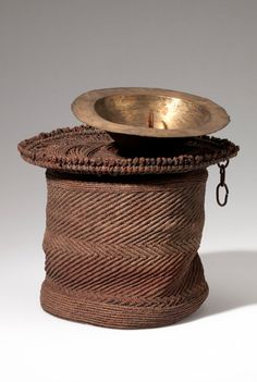 Africa | Prestige hat from the District of Lake Tumba, Equi'l Province; possibly Ntomba people. Belgian Congo | Plant fiber, wood, metal, hide, cord | ca. 1910.