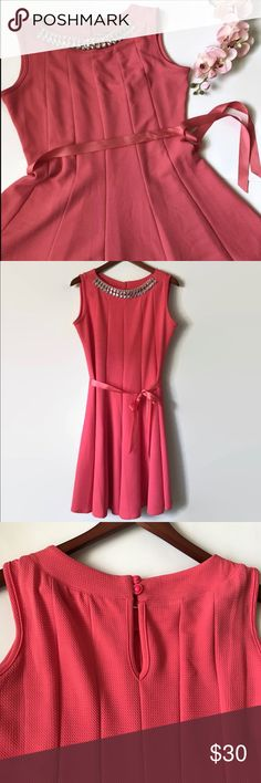"🎉HP🎉Be still my heart dress Hello darling! Slip into this ultra soft fit and flare for your social meet up today! Flattering slip on dress with a 2 button closure in the back. Built in necklace piece and ribbon waist tie to complete the look. LOTS of stretch!!! The color is coral. (tiny spot by the necklace, shown in the last photo. Barely noticed! Price reflects this imperfection).  Materials: 95% polyester 5% spandex Bust: 40"" waist 35"" Length 38.5"" Size: 2XL (tag says PL but this fits…"