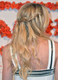 40+ Braids to Inspire Your Summer Hairstyle: January Joness loose braids blended beautifully into the rest of her hair, creating a peek-a-boo effect at a Childrens Defense Fund benefit in April. : Jennifer Morrisons waterfall braid is the perfect complement to your beachy waves this Summer.