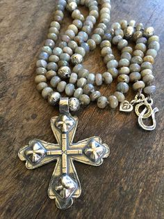 Gorgeous semi precious labradorite stones hand knotted featuring a handcrafted designer sterling silver cross. Artisan sterling and fine silver
