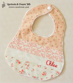 Personalised patchwork baby bib 'Apricots Cream' - floral girl bib with hand embroidered name Sewing For Kids, Baby Sewing, Handmade Baby Quilts, Patchwork Baby, Handmade Gift Tags, Cool Baby Stuff, Baby & Toddler Clothing, Baby Bibs, Burp Cloths