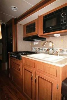 2016 New Forest River Wildwood 281QBXL Travel Trailer in Alabama AL.Recreational Vehicle, rv, 2016 Forest River Wildwood281QBXL, 6 Gal. Gas DSI Water Heater, CENTRAL SWITCH COMMAND CENTER, Coach-Net Roadside Assistance, Decorative Curtain Rods, Double door refrigerator, Ducted A/C, DVD, MP3, CD, FM Stereo, Exterior Camp Kitchen, Foot Flush Toilet, Full Extension Drawer Guides, Led Awning Light, Night shades, NITROGEN FILLED TIRES, Outside Speakers, Pass Thru Storage, Power Awning, Power…