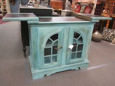 Small vintage turquoise buffet. White & antiquary distressed.   Height: 33 1/2 inches  Width: 18 1/2 inches  Length w/table out: 56 inches  Length w/table in: 37 1/4 inches