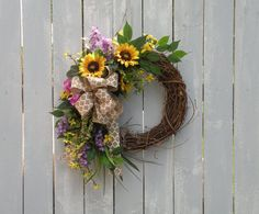 Introducing my new 2016 Spring/Summer Collection..... I will be adding new designs to my shop so please add me to your favorites list and watch for new listings weekly!  This grapevine wreath is created with a lovely mix of sunflowers, burlap and color! This wreath measures 30 inches long by 26 inches wide and 8 inches deep. Make this wreath a great update to your home or front door. We always suggest to hang our products in a covered area if hanging outdoors.  Custom designed and carefully…