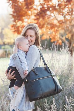 Motherhood is a job--invest in the gear that works. This leather backpack diaper bag transforms into a chic handbag when you drop your kids off, and comes with 12 pockets, a changing pad, and a removable, washable organization insert. Best Diaper Backpack, Diaper Bag Purse, Dad Diaper Bag, Black Diaper Bag, Leather Diaper Bags, Leather Backpack, Gender Neutral Diaper Bag, Best Baby Bags, Lily Jade Diaper Bag
