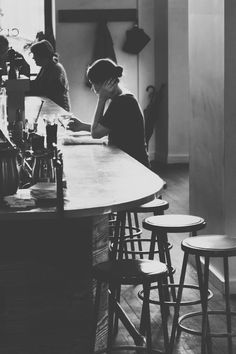 This photo is fun - Love how there's an extra person in the background but it still feels so solitary. I love the bar location because it screams situation to me, and I so want to know what else is going on.