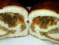 Sausage Bread:  1 roll of Sausage makes 2 loaves 1 roll of Hot Pork Sausage (I used Jimmy Dean) 2 Eggs Sharp Cheddar cheese-shredded 2 frozen bread loaves   Click Here for complete recipe:  http://www.q99fm.com/BreakfastClubFDT2013.aspx