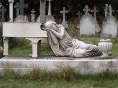 1.) Weeping at the piano. I wonder if she played... click on the picture to see the other bizarre graves from around the world