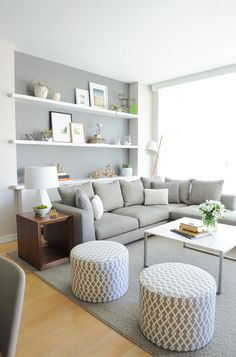 Cute  cozy gray living room | gray and white patterned ottomans | gray couch | gray walls | gray rug