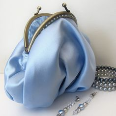 making formal dresses into dresses you can wear again and having a matching clutch