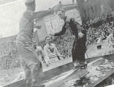 A halftime log-rolling competition between a Duck and a Beaver during the 1936 civil war football game in Corvallis.  From the 1937 Oregana (University of Oregon yearbook).  www.CampusAttic.com