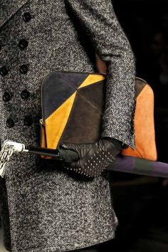 Studded gloves and cane.