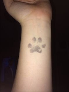 My most recent tattoo. My dogs actual paw print.