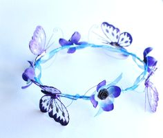 Purple and blue Pretty butterfly headdress enchanting whimsical flower fairy crown halo wedding flower girls festival prom by InMyFairyGarden on Etsy https://www.etsy.com/listing/209703379/purple-and-blue-pretty-butterfly