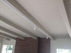 White beams, track lighting