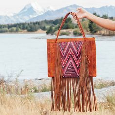 Make sure you stand out in style with this unique fringe tote, hand made with traditional Mayan Huipil bordered by a stunning fringe design. Double sided Huipil High quality leather Interior zip pocket and double slip pocket*Import *Puro Utz Pin Pin