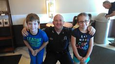 Off. Kelleher meets two visitors to Coffee with a Cop at Swan's