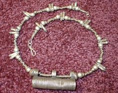 Antique tribally worn Ethiopian ethnic silver necklace with a mergaf pendant which was typically worn as a protective amulet.
