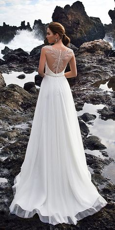 Nora Naviano Wedding Dresses For Charming Style ❤ nora naviano wedding dresses a line tattoo effect back with buttons ❤ Full gallery: https://weddingdressesguide.com/nora-naviano-wedding-dresses/ #bridalgown #weddingdresses2018 #wedding #bride