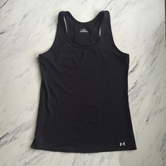 Under Armour work out top Like new black athletic work out top. Under Armour Tops Tank Tops