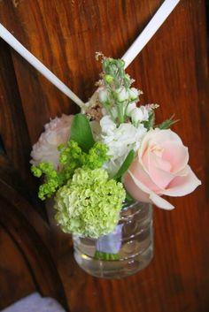 Pale Sage Green & Pink On the end of each alternate Pew end, we hung posies in jam jars of fragrant Stocks, Peonies, Roses, Astilbe, Viburnum Opulus and Eryngium