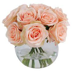 Silk pink rose arrangement in a round glass vase.  Product: Faux floral arrangementConstruction Material: Silk a...