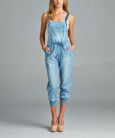Amp up your laid-back look with this distinctive denim jumpsuit that's defined by jogger cuffs and an overall-inspired bodice that exudes sunny-day flair. 11.75'' long from high point of shoulder to hem22.5'' inseam98% cotton / 2% spandexMachine wash; hang dryImported