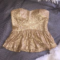 Gold Sequin Peplum Shirt! Strapless, gives good cleavage, pairs good with high waisted pants! Forever 21 Tops Blouses
