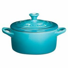 Covered stoneware casserole dish with a round shape and two side handles.  Product: CasseroleConstruction Material: StonewareColor: CaribbeanFeatures: 8 Ounces High-quality exterior enamel protects against metal marks and other damageDurable---yeah blah, blah..it's just cool.