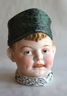 German Bisque Humidor in the Form of a Boy's Head by ThTalbot on Etsy https://www.etsy.com/listing/209600178/german-bisque-humidor-in-the-form-of-a