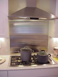 Stainless behind cooktop for easy cleaning.