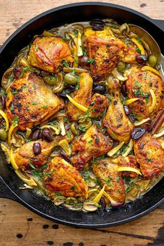 Chicken Tagine With Olives And Preserved Lemons Recipe -  Ingredients      5 cloves garlic, finely chopped     ¼ teaspoon saffron threads, pulverized     ½ teaspoon ground ginger     1 teaspoon sweet paprika     ½ teaspoon ground cumin     ½ teaspoon turmeric     Salt and freshly ground black pepper     1 chicken, cut in 8 to 10 pieces     2 tablespoons extra virgin olive oil     3 medium onions, sliced thin     1 cinnamon stick     8 calamata olives, pitted and halved     8 cracked green…