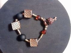 brown, black and glass bracelets.