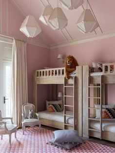 A subtle pink paint color with just a touch of gray—Calamine by Farrow & Ball—makes the room appear fresh and delicate. Tasseled Anthropologie pillows are piled on the floor, while a series of RH Baby & Child light fixtures hang overhead. Farrow Ball, Anthropologie Pillows, Modern Bunk Beds, Bunk Rooms, Bedrooms, Kids Bunk Beds, Daughters Room, Loft Spaces, Little Girl Rooms
