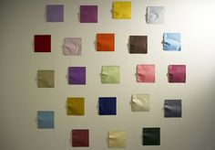Though at first glance you'd think you were just looking at a bunch of colorful construction paper pieces neatly arranged on a blank white wall, come a lit