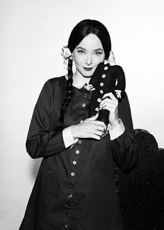 Carolyn Jones as Morticia Addams.
