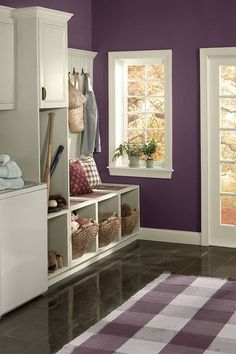 Love the organizational ideas in this mudroom with Benjamin Moor Kalamata AF-630 purple paint on walls, Pantone color of the year 2014 radiant orchid