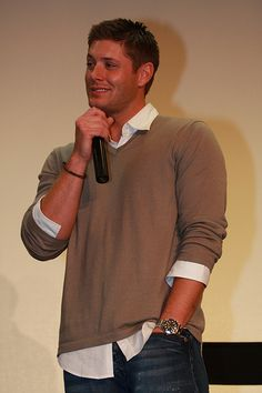 Jensen in a sweater and dress shirt omg I can't breathe