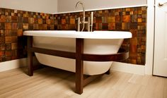 Reclaimed barn wood and up-cycled cabinet bathroom tiles. Awesome bath too. Click for details.