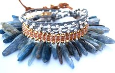 This piece is AMAZING! I totally want to make this :) Tracy Statler design using a unique stitch for a reverse style of leather beaded wrap bracelet (like the one pictured in the middle of the photo).