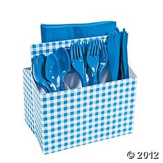 """Blue Gingham Tableware Caddy @Oriental Trading: $3.75 each. When you're gearing up for picnics, BBQs or any summer celebration, there's nothing better to set your table w/ than our array of Gingham party supplies! This Caddy is just what you need to easily carry cutlery, napkins or hold condiments at the table while keeping them organized. This caddy contains 3 pockets on one side & a long 7 1/2"""" pocket on the other for a total of 4 areas to neatly hold all your tableware."""