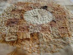 natural dyeing with rust, hand stitching by Penny Berens
