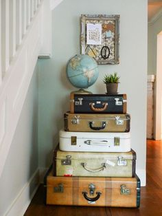 Vintage suitcases stacked in a small space add storage