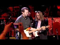Nov 29th, 2002 - exactly 1 yr after George Harrison's passing - a group of his musical friends including Clapton, Ringo, Paul, Jeff Lynne, Tom Petty, Billy Preston and many others got together at the Royal Albert Hall to pay tribute to the music of George. If you have not ever seen it...do look it up on YouTube - from that amazing concert, here's the finale with the most of the performers playing the Harrison tune 'Wah-Wah' lead by Clapton and Jeff Lynne.
